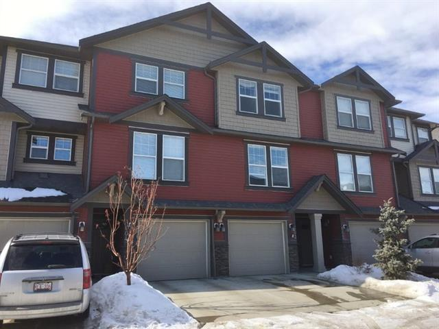 HERE IS YOUR OPPORTUNITY TO GET INTO A BEAUTIFUL AFFORDABLE CONDO ON THE WESTSIDE OF AIRDRIE WITH IMMEDIATE POSSESSION AND MOVE IN READY !! - ALL FRESH PAINT THRU OUT AND NEW CARPET !!LOCATED RIGHT ACROSS FROM A 60 ACRE NATURE RESERVE WITH WALK AND BIKE TRAILS !! STEP ONTO YOUR BALCONY OVER LOOKING A DELIGHTFUL COURTYARD OF GREEN SPACE & TREES - THIS 2 STOREY TOWNHOUSE HAS 3 BEDROOMS INCLUDING LG TILED ENSUITE & 4 PIECE BATH & A 2 PIECE ON MAINFLOOR - VERY SPACIOUS LIVING/DINING/KITCHEN AREA - GROUND LEVEL HAS INSIDE TANDEM STYLE PARKING/STORAGE/MAN CAVE AREA  WITH  WALK OUT ONTO PATIO AREA - TASTEFULLY DECORATED THRUOUT WITH WALL MOUNTED TV IN LIVING ROOM INCLUDED - GRANITE COUNTERS - LOTS OF KITCHEN CABINETS - STAINLESS STEEL APPLIANCES & BREAKFAST BAR IN KITCHEN OVERLOOKING THE COURTYARD - LOCATED ON THE WESTSIDE OF AIRDRIE JUST OFF VETERANS WAY & CLOSE TO SCHOOLS & PLAYGROUND - VERY DESIRABLE AREA & QUICK POSSESSION SELLER IS RELATED TO REALTOR