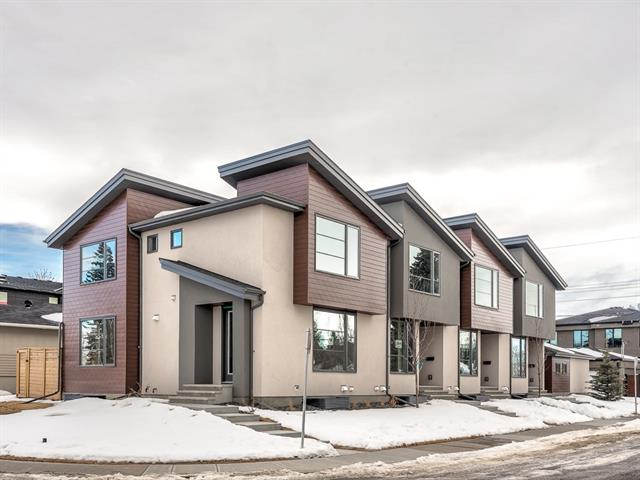 OPEN HOUSE SUN APR 14 FROM 2-4!! Welcome to Park Urban in Banff Trail - a modern and contemporary Executive Row Home built by Baywest Homes. Located on a corner this wide open home has 6? white oak hardwood flooring flowing throughout the kitchen and separate dining and great room area. The kitchen is well suited with beautiful cool grey cabinetry and stunning full height backsplash, a central working island with white quartz countertops and stainless steel appliances including a gas range. The Great Room at the back of the home features a french door leading out to the fully landscaped back yard. There is a very cool glass wall going upstairs to the 2 master suites. Both with their own 4 pc ensuite baths. Laundry is tucked away on the upper floor as well. The lower level is fully developed with a rec room, 3 pc bath & bedroom.