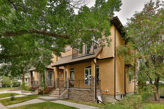 Executive inner city infill attached home is minutes to downtown! Built with quality finish, this large home has an open plan with 9' ceiling on main floor, GORGEOUS Jatoba Brazilian Cherry Hardwood NEWLY SANDED & REFINISHED (April 26, 2019), 3 sided gas FP and more! Upscale features with stair lighting, New fresh lacquered Kitchen cabinets, granite countertop, designer tiled back splash & large pantry. Upper level features 3 good sized bedrooms, skylight over metal spindled staircase plus a large upstairs laundry rm. Large Master Bedroom cathedral ceilings small balcony, walk-in closet, beautiful soaker tub in BRAND NEW Ensuite. Exclusive new lighting & designer paint throughout the house. Intercom speaker system. Fully developed basement with possible 2 more bedrooms and office. a full bath, in floor heating. Fully landscaped backyard with deck, double garage & extra parking pad for 3rd car or small RV. Completely redesigned and renovated Master bathroom Jan 2019.Awesome value. Check out the live video!