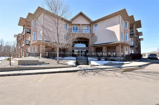 Welcome to this spacious 2 bedroom 2 bathroom condo on the top floor of the Highwood Springs Estates.  Large master suite with adjoining closets and an ensuite with double sinks and separate bathtub and shower. The living room is bright and has a gas burning fireplace.  A separate dining area outside the kitchen is separated from the kitchen by an attractive breakfast bar.  The apartment as its own laundry room and small storage area. A second 4 piece bathroom and second bedroom complete the space.  This unit as a titled parking spot and a titled storage unit located in the garage