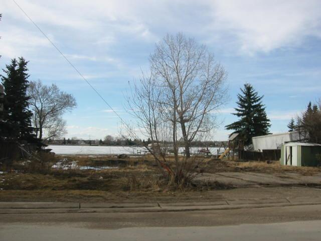 Huge extra wide lakefront lot. 82ft wide by 285 ft deep. Located on desirable south portion on east side of Chestermere Lake, with rear yard facing west for lots of sunshine, and mountain views. This building envelope can accomodate just about any size home you could desire,  and depending on the plan, probably accommodate a 4 car garage.