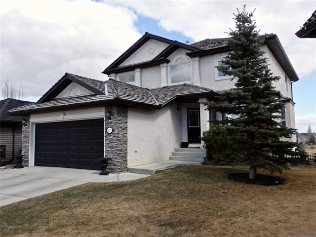 OF THE MANY HOMES FOR SALE IN AIRDRIE, none COME CLOSE to this one's SUPERIOR LOCATION! Buy location first, it will always reward you in all ways - every day and in the long term too! Located at the end of a cul-de-sac, this 2350 sf grand 2-storey, full walk-out 4 bedroom home backs to the beautiful Woodside Golf Course! The all-encompassing view from this home over the course is truly panoramic and will never be taken away! Lesser homes have views - of neighbouring homes - this has a view to live for - a view that makes you happy every time you wake up in the morning and drink it in! Custom built for the only owners, this beauty is comfortable and spacious. The vaulted entry greets you, followed by the welcoming living room & spacious dining room. The main floor laundry is convenient. Notice the granite-loaded kitchen with island breakfast-bar, stainless appliances, ceramic top range, custom tile backsplash & wine fridge too! Also note the nook, comfortable family room with cosy gas fireplace, and then