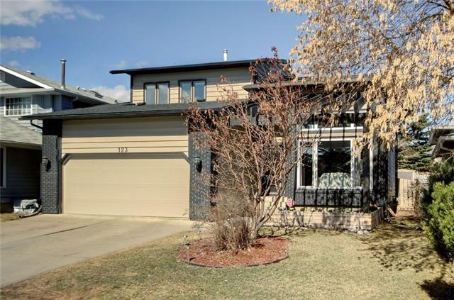 Nestled on a quiet street in between a green belt/off leash dog park & bike/walking paths of Fish Creek Park along the Bow River, you will find this amazing 2 storey home! Gorgeous curb appal with a front covered patio & garden area. As you enter into the grand foyer, the expansive windows warms you with natural sunlight from the south exposure. Vaulted ceilings stretching all the way to the 2nd floor, skylight & spindled staircase accentuate the openness of the space. The living room is open to the 2nd floor loft space. Gleaming hardwood floors throughout main level. Formal dining room, modern kitchen with large island, extended height cabinetry, granite counters, stainless steel appliances & tiled backsplash. Sunken family room with cozy corner gas fireplace. Three large bedrooms up incl master retreat with a relaxing 5 pc ensuite, dual sinks, stand alone shower, soaker tub, patio door walkouts out to balcony overlooking backyard. Please view additional remarks.