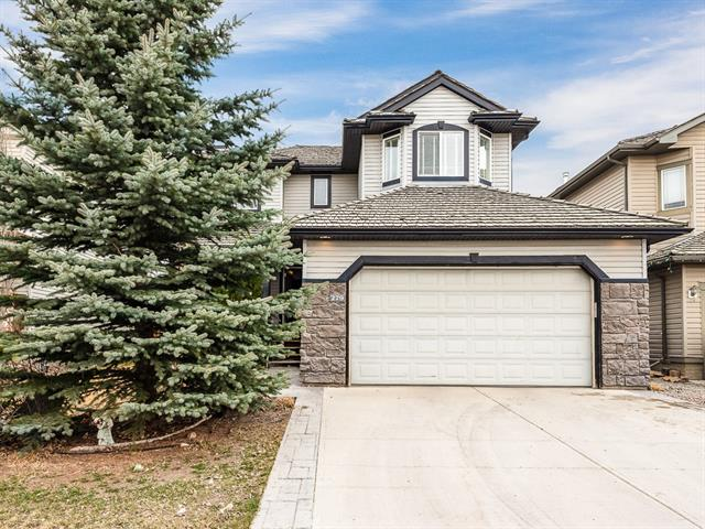 Two storey home with fully finished basement backing onto The Links of Gleneagles golf course in the picturesque community of Gleneagles in Cochrane. Main floor boasts a spacious kitchen with corner pantry, tiled backsplash, stainless steel appliances and island with raised eating bar. Adjacent living room is accented by gas fireplace and large picture window allowing for loads of natural light. Dining room has patio door leading out onto the large deck overlooking the rear yard and golf course beyond. Front flex room is ideal for a home office and laundry is conveniently located on the main floor. Upper level boasts three bedrooms and a bonus room with master having a four-piece ensuite and walk-in closet. Fully developed basement has a huge rec room, three-piece bathroom and additional flex room. A fantastic property nestled in a sought-after location on a quiet family friendly street.