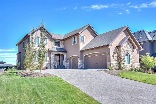 Welcome to your very own CASTLE in a secluded and posh enclave in the Calgary's SW. There are AT LEAST 10 REASONS WHY YOU SHOULD VERY STRONGLY CONSIDER BUYING THIS MASTERPIECE: 1) LOCATION - quite cul-de-sac, no traffic, amazing pathways in the area, proximity the famous Spruce Meadows, short drive to South Campus Hospital, Bragg Creek, etc. 2) LOT SIZE - over a 1/3 of an acre lot makes this estate property a mini acreage! 3) STATE OF THE ART CHEF'S KITCHEN with high end appliances and GRANITE COUNTERTOPS 4) FUNCTIONAL MAIN FLOOR LAYOUT that allows for entertaining guests and cozy family time. 5) Have you ever wanted a very cool CURVED SEE THROUGH STAIRCASE? You will have it here! 6) STUNNING MASTER BEDROOM SUITE with a soaker tub, built-in closet shelving and drawers. 7) BONUS ROOM and 2 more SPACIOUS BEDROOMS UPSTAIRS. 8) WALKOUT BASEMENT - a fun place with a huge rec room, 4th bedroom , full bath and access to a (9)LARGE COVERED PATIO and HUGE BACKYARD.