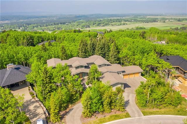 A stunning masterpiece in Calgary's west end on 1 FORESTED ACRE, this exquisite Posthill 6 bedroom custom two-storey walkout home fuses West Coast Contemporary & Prairie Modern styling into a breathtaking, cohesive blend of elegance, clean lines & warmth. Entering the home you are immediately captivated by the serenity of the great room with the calming forest framed through the floor to ceiling windows. Thoughtful layout & design is apparent in every detail of the 9300+sqft home - from the luxurious main floor master retreat, the gourmet custom sapele wood kitchen to the clear distinction of space in the upper level with a south staircase to the exclusive office retreat & the north staircase accessing the 3 upper level bdrms, all with personal ensuites & enchanting forest views. Featuring the finest craftsmanship & materials, this luxury property is also minutes from west Calgary?s coveted public & private schools & offers exceptional access to downtown & the Rocky Mountains