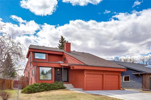 Meet DENVER - AMAZING PRICE/SQ FT! The stylish 5-level split with MID-CENTURY MODERN charm, just steps from Fish Creek Park! This BEAUTIFUL and UNIQUE home has been thoughtfully updated throughout. The black slate tile and engineered hardwood flooring, custom wood & glass railings, designer light fixtures, and Nest thermostat are sure to please. The kitchen dazzles w/ clean lines, acrylic/glass Eurostyle cabinets, Caesarstone counters & upgraded appliances. The family room w/ WOOD-burning fireplace leads to the massive PRIVATE deck w/ horizontal-slat privacy wall & SOUTH-facing fenced yard. Upstairs has a large lofted BONUS room, 2 addtnl bdrms & full bath w/ black hex tile floors. The master comes with a WALK-IN closet and ENSUITE w/ glass door tiled shower. The finished bsmt offers a 4th bdrm, family/flex room and plenty of STORAGE. Main floor laundry, convenient half bath for guests, and DOUBLE ATTACHED garage. All this on a QUIET street close to parks, schools, transit & shopping!