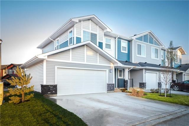 END UNIT, DOUBLE CAR GARAGE IN A PREMIERE location that's sure to make your life at home a little easier and more peaceful! Trendy urban-style townhome comes complete with a unique floorplan and offers an affordable lock and leave lifestyle. Tons of perks and with features such as 2 bedrooms and a loft, 2.5 baths, quartz countertops, laminate flooring throughout, open concept and bright main floor, soft close drawers, track lighting and more, why not come and have a look! 6 Appliances including Washer, Dryer, knock down 9' ceilings in main living areas, full height designer shaker kitchen cabinets and window coverings. Quiet and peaceful with the environmental reserve just steps away from your new home. This Townhouse has a separate fenced yard and also includes a DOUBLE attached garage. Come by the Show home located at 2508 Jumping Pound Common for more information. Builders reg size= 1137 sq ft/ RMS size = 1088sq ft