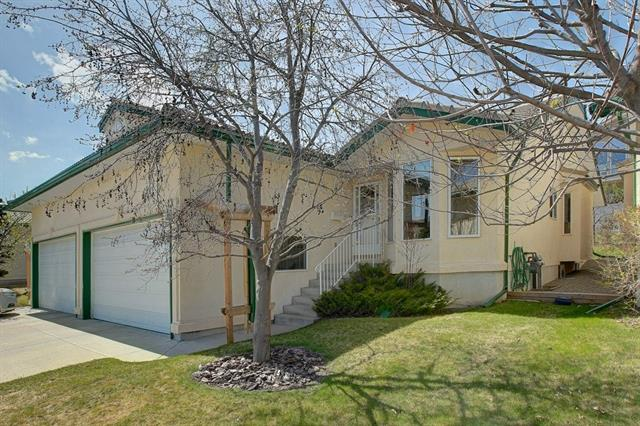 Executive custom-built Villa Bungalow with fully developed basement and double attached garage in show home condition. Original Owner. Total of 3 bedrooms, main floor office and 3 bathrooms. Very bright and open plan with vaulted ceilings. Bright and sunny kitchen with centre island, pantry, breakfast eating bar open to large dining area and huge great room with gas fireplace. French door leading out to secluded west backyard with concrete patio. Larger master bedroom with his and her closets with 5-piece spa like ensuite with jetted tub and oversized shower. Main floor den, huge laundry room and 2-piece powder room. Professional developed basement with large family and games room with gas fireplace. 2 bedrooms and 4 piece main with large storage area.  Double attached garage. Pride of ownership shown throughout.  Ideal for empty nester or professional.  Walking distance to LRT, Schools & amenities and easy access to Bow Trail. Exceptional Value!