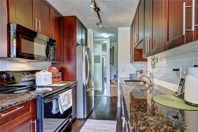 """Welcome to """"Greenview on the Park"""", this beautiful 2 bedroom condo located close to schools, city pathways, public transit, over looking a green space with proximity to playgrounds and off-leash park.  Only 10 minutes away from Calgary Downtown.  Features include granite counters, shaker espresso stained maple cabinets, new appliances, engineered hardwood flooring, designer ceramic tile in common areas and carpet in bedrooms.  In-suite storage and laundry."""