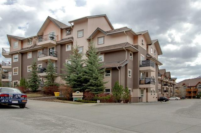 This completely renovated Canmore Condo is a real jewel. Stainless steel appliances, new paint, new high density carpet, new faucets and a new curtain in the open concept kitchen-dining-living area make this unit bright and clean like new. The unit has a great layout with two good-sized bedrooms on opposite sides, Master with an ensuite bathroom and walk-through closet and a generous living space in the center. Enjoy stunning mountain views from the third-level South-facing deck! An assigned parking stall w. plug-in, a laundry area right around the corner, extra storage downstairs, bike storage, elevator and a free exercise room complement this beautiful unit. Fairholme Village is an attractive locally-managed residential building with reasonable condo fees, a welcoming foyer and visitor parking, in a good neighbourhood, close to downtown Canmore.  This awesome unit sets the stage for a fantastic home in the Rocky Mountains. No employment requirements. Vacant and easy to show!
