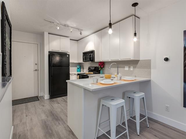 Welcome to The Morgan! This amazing main floor unit is the perfect home for a student, a professional or as an investment opportunity. Within walking distance to Mount Royal University and amenities galore including a Tim Hortons, Restaurants, Drug Store, Domino?s Pizza & more. This unit feels so much larger than 448 sq ft with the newly renovated open concept kitchen/living room and wall separation to the bedroom plus more storage than you would expect. There is in-suite laundry & fireplace plus easy access to your garden from the patio doors! You can walk almost everywhere from here but if you do have a car and don't like wiping it off in the winter there is a titled underground parking spot and if you have a lot of stuff there is an additional storage locker! With all utilities except electricity are included in your condo fees, it is easy to budget costs here as well. This building is well managed and features great amenities including a fitness room, party room, guest suite, and on-site managers.