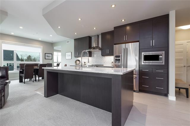 """This is the premier location for the young professional! This 2 bedrm + Den model has a great open concept floor plan with 9' ceilings in the desirable """"The Armory"""" - Adult only A/C building with State-of-the-Art surveillance. This corner floor plan does not come up for sale often! Located on the 3rd floor it has it's own private west facing  balcony. With amazing views of the mountains, playground, park / Currie Barracks! Premium condo has high end details with a Gourmet Kitchen; stainless steel """"KitchenAid"""" appliances, granite sink, quartz counter tops/ backsplash, pot lights, flush eating bar & solid wood drawers/cabinets with soft close action. With the cabinets right to the ceiling & professional series hood fan - truly WOW style! In suite laundry with space for storage. Indoor titled parking & individual storage area to keep your extra items safe out of the way. The building is perfectly located with close proximity to the Marda Loop area, Mount Royal University, Shopping, Food, Transit & Starbucks!"""
