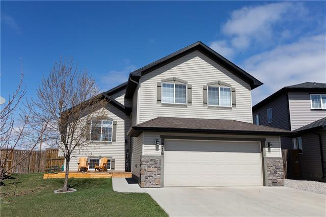 Tired of cookie-cutter floorplans? This immaculate home built by Aquilla Homes has definite WOW appeal & is located on a quiet cul-de-sac on a pie shaped lot in prestigious Hillview Estates.  Features incl 3+1 bdrms, 2 full baths & a partially finished lower level.  The main floor has vaulted ceilings & incl an open concept living room & kitchen, 2 large bdrms & a full bath.  Open in design, the living room incl a gas fireplace & a space for a tv.  The kitchen boasts an electric stove top, built in oven & microwave; a raised eating bar, corner pantry, a large dining area & gorgeous, custom built maple cabinets.  You'll love the spacious, luxurious spa-inspired master suite which features a soaker tub, separate shower & a large walk-in closet.  The lower level is partially finished, boasts 9' ceilings & incl a family room area, games room, a 4th bedroom & a laundry room that is roughed in for a 3rd bath.   The over-sized pie-shaped yard includes a multi-tiered deck, raised planters & a storage shed.