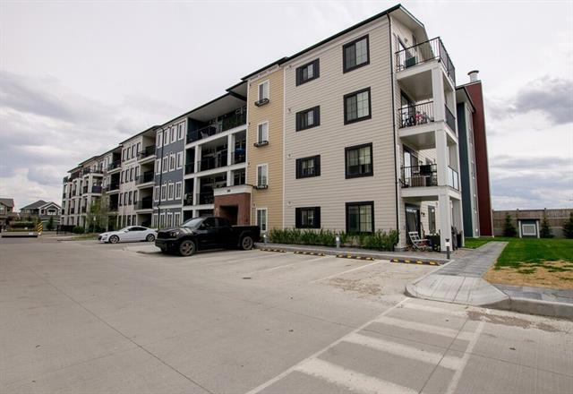 PRICE REDUCED!! Exceptional value in this 2 bedroom 2 bathroom unit by Brad Remington Homes at the Sam Award Winning My Legacy Park Development. Comes with a title parking stall in the underground heated parkade.  Open concept living space with a galley style kitchen leaving space to add a dining table or island. Dark cabinets with sleek stainless steel appliances. White quartz counter-tops that carry into both bathrooms. Bright space with neutral colors to add your own personal touch. Patio doors out to your private patio with a gas hook up for the BBQ. The master bedroom has a walk through closet to access the 4 pce en-suite. Convenient in suite front load laundry & storage, with additional storage space outside the unit.  Within the community, 15 km of paved walking paths guide you past serene ponds, bright playgrounds, community gardens and manicured green spaces. Close to many amenities including restaurants, shopping & transit. Great playground & park right across the street.