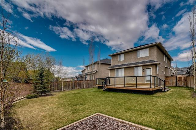 Lowest priced home in Aspen! This Trico home features 4 bedrooms, 3.5 baths and a huge south facing pie-shaped lot with tiered decking! Great room plan with 9 foot ceilings features a large living room with gas fireplace, island kitchen with pantry and stainless steel appliances and dining room open to the oversized deck and backyard. Upstairs you have a bright and open bonus room, 2 kids bedrooms, one with a walk-in closet, laundry and a master with a walk-in closet & 5-pc bath with separate toilet, shower and soaker tub. Fully finished basement with bedroom (no closet), 3-pc bath with heated floors, family room and lots of storage. Large double garage plus mudroom area at back door. Beautifully landscaped yard with fence and mature trees for added privacy - not looking at other houses. A great location on a quiet street just a short walk to Aspen Landing, Starbucks, shops, schools and walking paths. A must see! Last chance to buy before they rent it out! Great investment!