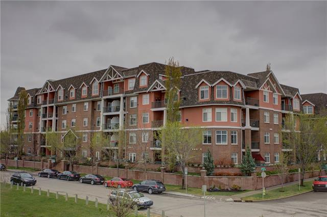 Executive main floor apartment condo with 1 bdrm pulse a den. With a rare secured tandem double garage. Very bright & open plan with lots of windows. Bright kitchen with breakfast eating bar open to large dining area, great room with gas fireplace & flex area, ideally for sitting or office area. Large master bdrm with walk thru his/her closets & a 5-pc ensuite with large soaker tub & O/S shower. 3-pc main bath & in suite laundry. Large office/flex rm with double French doors with a built-in murphy bed. French doors off dining area leading out to a secluded gated patio & courtyard with gasline for a barbeque. Pride of ownership shown throughout. Quiet location steps from LRT, Stampede & minutes to downtown. Secured underground parking stall (#365) & storage locker (#61) with the parkade having 2 car wash bays. All utilities are included except for electricity + you have access to a library, a games room with pool table & a theatre room/common area. Ideal for professional or empty nester. Exceptional Value!