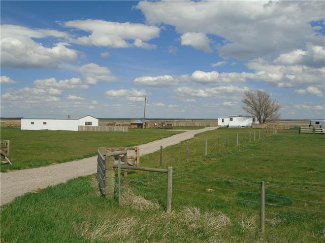 COMPLETE HORSE SET-UP!  7.98 ACRES.. JUST WAITING FOR NEW OWNERS!.. Location 13005 Range Rd 260..  ONLY 10 MINUTES TO CLARESHOLM AGRI-PLEX..   OUT DOOR ARENA - 110' X 150'..  50' ROUND PEN.. POLE SHED, 5 PENS, NEWLY FENCED..  2  SHELTERS, NEW GEO THERMAL WATERERS..  OLDER SHOP 22' x 42', IDEAL WORSHOP & TONS OF STORAGE..  LOADS OF SPACE FOR YOUR ANIMALS..  HOME OFFERS NICE BIG LIVING ROOM.. SPACIOUS KITHEN & DINING AREA.. 4PC BATH / ADJACENT TO THE MASTER BEDROOM.. 2 OTHER SMALLER BEDROOMS.. YOU;LL LIKE THE NICE BIG ENTRY/ PERFECT FOR ALL BOOTS & ATTIRE.. HANDY WITH LAUNDRY RIGHT THERE.. BASEMENT OFFERS LARGE COLD ROOM/ LOADS OF SPACE FOR WORK AREA OR DEVELOP AT A LATER DATE..  PULL YOUR RIG IN OFF THE PAVED ROAD RG RD 270, THAT TAKES YOU TO CLEAR LAKE JUST 5 MINUTES AWAY..  CALL FOR YOUR PERSONAL TOUR
