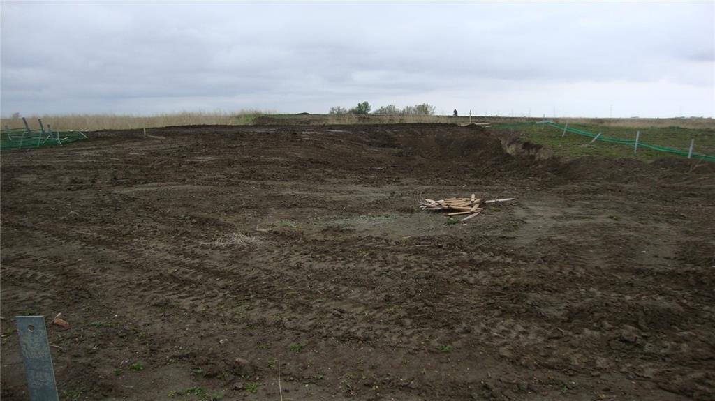 Building lot 54.79' x 114.8' in the Pines subdivision in Stavely, Ab. The hole for the foundation was previous dug and recently filled back in.