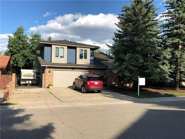 **THIS IS A BIG FAMILY SPECIAL**Do you have a large family and need an amazing place to call home? Do you want to be in one of the best neighborhoods of the city? This home may very well be for you! There are at least 7 reasons why you should strongly consider it: 1)Bedrooms count - if you have lot of kids - watch this - 4 bedrooms up/1 down! 2)Renovations - this house was completely update inside - the bathrooms, the kitchen(granite counters, fancy S/S appliances, tiled flooring, new cabinets), the flooring, paint, light fixtures. 3)**THE GYM/WORKSHOP ROOM** - you won't likely find anything like this - the huge indoor pool was converted into an amazing GYM - 30'x24'(can be used as entertaining room) - absolutely amazing space for kids, workshop, etc. 4)RV parking + oversized double garage. 5)Schools - Oakridge is famous for its Louis Riel School with the science program(walking distance). 6)Glenmore Reservoir - steps away. 7)The cool stuff: 2 wood burning FPs, open beams, wet bar, sauna. Come see it now!