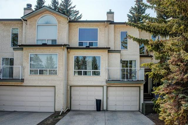 OPEN HOUSE Sat 24th Aug 11.30am -1.30pm. Just Reduced. AMAZING NEW PRICE!! Fantastic townhome in desirable Strathcona.  Imagine having your own DOUBLE ATTACHED GARAGE.  Main floor features 2 DECKS. One to the east for morning coffee watch the sunrise and another PRIVATE deck to the WEST off the kitchen.  Large family room with focal fireplace is the perfect spot to unwind.  Upstairs the huge master suite has partial views of downtown and loads of storage.  The 5 piece main bath features dual sinks, large tub, and separate shower.  There is a 2nd bedroom and flex den on this floor that could be a home office, a second TV area, or 3rd bedroom.  Lots of storage in the lower level. Seller will even give a credit to update the carpet, make your own choice to instantly update this lovely home. Walking distance to C train, parks and playgrounds and the beautiful Ravine pathways in the area.  Fantastic schools in the community. Well managed and maintained complex.  10 min to Downtown.