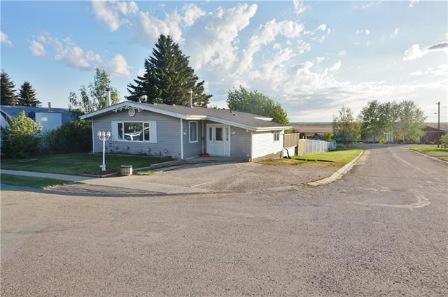 Escape the hustle and bustle! Spacious bungalow nestled in the quiet community of Torrington. Only 20 minutes East of Olds and approximately the same drive to Trochu and Three Hills. Open concept greets you as soon as you enter this home, from the grand entrance to the large living room and dining area. Kitchen is a galley style with ample counter space that wraps around into the living area. Spa style bathroom and 3 bedrooms complete the main floor. Basement development includes another nice size bedroom, laundry area/ storage, 3 piece bathroom and a huge family room with walk out to patio , fire pit and rear yard. Lot is completely fenced with chain link and measures 50? x 188? so building a nice size garage or shop, would complete the dream! Great retirement home or bring your whole family! Call today to view!