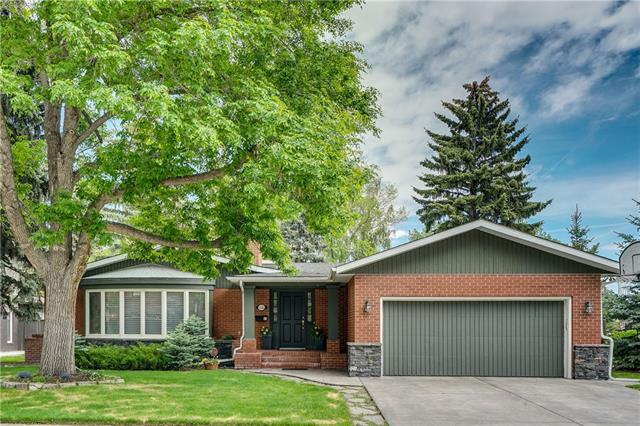 SPACIOUS, ELEGANT BUNGALOW on a quiet street in Mayfair siding to a park where your kids can play in the summer or skate on the ice rink in the winter! DOZENS OF UPDATES make this home special:  Beautifully re-landscaped yard with new PATIO, FIREPLACE, BARBECUE AND HEATERS, NEW SPRINKLER SYSTEM, GRANITE KITCHEN COUNTERS, NEW SHINGLES (2016), FURNACE REPLACED (2011), PLANTATION SHUTTERS and CUSTOM BLINDS.  Other features include:  HUGE ENTRY WITH MARBLE FLOOR perfect for welcoming guests, Formal living and dining rooms, GOURMET KITCHEN with upscaled appliances and SKYLIGHT opens to a cozy FAMILY ROOM WITH RIVERSTONE FIREPLACE.  THREE BIG BEDROOMS including a master with SPA LIKE ENSUITE BATH.  MAIN FLOOR DEN overlooking the back yard where South Sun brightens your day. FULLY FINISHED LOWER LEVEL with guest room, bath, and entertainment areas plus tons of storage.  Double Attached Garage, Mud Room, Main Floor Laundry and so much more!