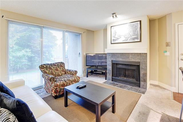 Excellent opportunity to purchase a 2-bedroom, 2-bathroom condo in The News at Broadcast Hill. Updated throughout. Kitchen has granite counter tops, maple cabinets, black appliances and a raised breakfast bar. Open to the dining room and living room with huge windows bringing in plenty of sunshine. Wood burning fireplace adds to the 'Canmore condo' feeling of this home. Step outdoors to your East-facing patio to enjoy your morning coffee.  Ensuite has glass-walled shower, and second bathroom has bathtub with shower. Convenient in-suite laundry (washer and dryer included!). Indoor parking (stall #4) and separate storage (unit #2). The complex includes swimming pool, fitness room, hot tub, party/meeting rooms and tennis court - no need to pay fees to a fitness centre when you live here! Beautiful landscaping includes paths throughout the complex and lovely waterfall feature. Located perfectly for quick access to downtown or the mountains. Condo fees of $461.05 include heat. Welcome home!