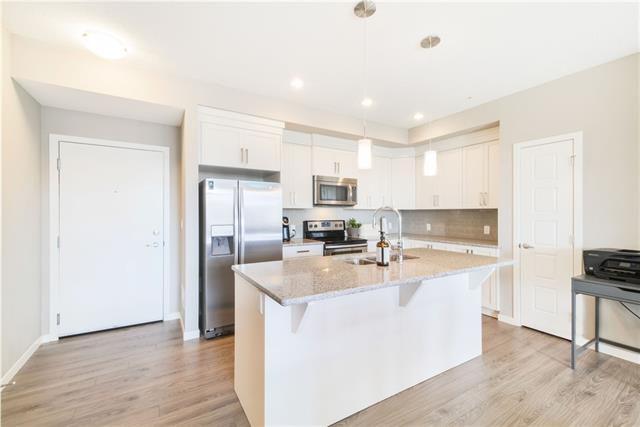 Welcome to this very well maintained 2 bedroom 2 bathroom condo.  From the moment you walk in you will feel right at home with the open floor plan, quartz coutertops, tile backsplash, stainless steel appliances, 9 foot ceilings, upgraded vinyl plank flooring, and much more.  The large balcony with gas hook up for the bbq, has a beautiful view of the courtyard / green space.  Close to schools, shopping, restaurants, south health campus and more! The New Brighton clubhouse has skating, community center, parks, fitness classes, splash park, tennis and more. Easy access to Stoney/Deerfoot. Direct commute to downtown with BRT/Express busses. You will be happy to live in this amazing community!