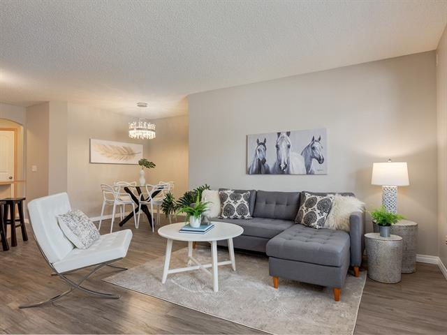 This original owner is ready for someone to create their own memories in this bungalow-style townhouse. This 2-bedroom unit is one of the largest floor plans available & has been exceptionally maintained! With its open layout, you can take notice of the several UPDATES: FRESHLY PAINTED, NEW LVP FLOORING & BASEBOARDS throughout (2018), NEW BACKSPLASH, updated LED lighting?just to name a few. Tired of street parking? Look no further?this unit is a rarity as it comes with 2 PARKING STALLS! With its LOW CONDO FEES, you can also expect AFFORDABLE utilities (large windows that flood the space with natural light & radiant in-floor heating). Equipped with TANKLESS HOT WATER (serviced 2018), you will also never run out of hot water again! OTHER GREAT FEATURES: huge corner pantry, large kitchen island, laundry room, STORAGE ROOM, ample visitor parking, PET FRIENDLY, great management & FINANCIALLY SOUND. The location is superb as it is QUIET & close to all amenities (shopping, restaurants, transportation, etc).