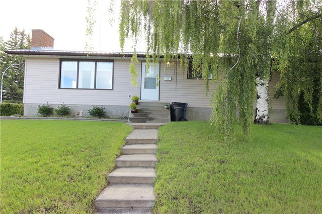 Welcome to 29 MCALPINE PL. This affordable HUGE BUNGALOW on a LARGE CORNER LOT in Carstairs is waiting for new owners. Walk in the front door to a huge entry & living room with big front window & wood fireplace. The main floor is super BRIGHT  OPEN CONCEPT between the Dining & living. You will find an UPDATED 4pc BATHROOM on the main & 3 piece en suite.The kitchen has warm wood cabinetry,SLS Appliances,breakfast nook and completing the main floor with 3 good sized Bedrooms. Downstairs is featuring huge living room , two good size bedrooms, 3 pc BR and huge storage and waiting for your personal touch as per needs. Backyard is the beauty of this Amazing Bungalow, The Covered patio is perfect for ENTERTAINING, RELAXING & ENJOYING with your loved ones. . With your updating ideas & the Retro features in the house it will be an amazing and UNIQUE home for your family. Double detached over size garage, Backyard fully fenced and new metal Roof is just a bonus, Shows great, Available for quick possession.