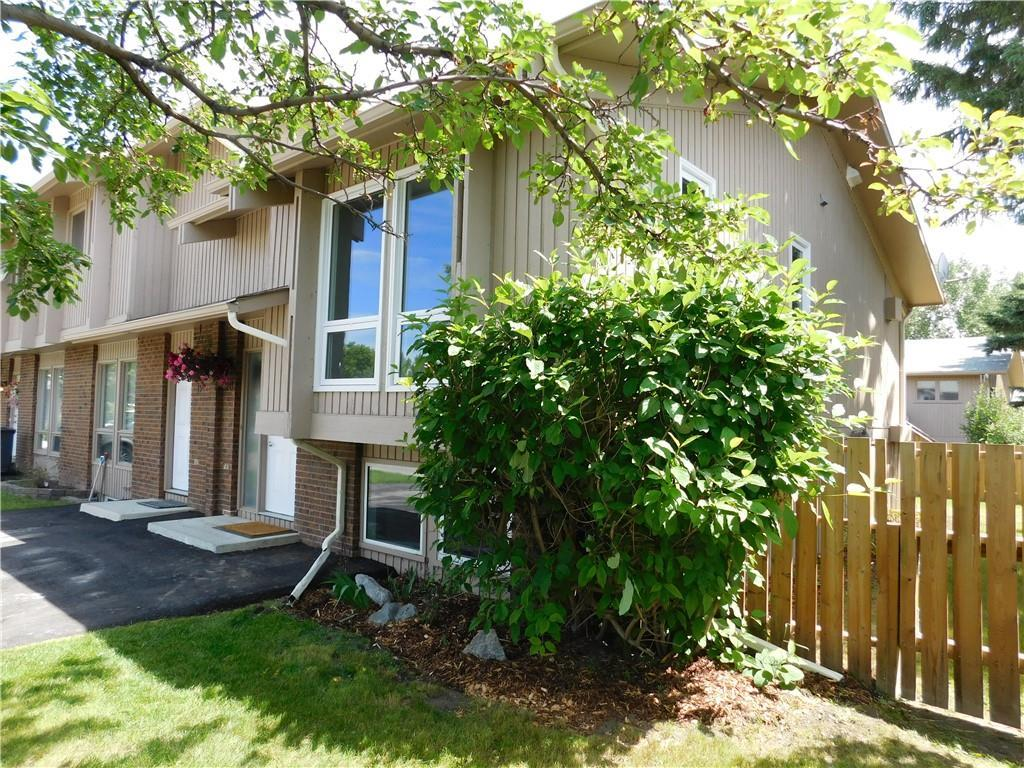 Idyllic setting for this renovated bilevel condo.  End unit with very large fenced yard sits adjacent to the Town Farm Community Garden and the outdoor rink.  Just steps away is the Happy Trails walking path.  All new windows/doors in the main floor in 2019, lower floor windows replaced in 2012.  Two windows have been added to the living room.  New carpet/vinyl plank flooring 2019, all new internal doors and trim 2019, all repainted and just waiting for you.  Large deck added in 2012.