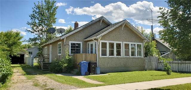 Attention Investors, first time home buyers or maybe you are looking to downsize?  This 1001 sq.ft 2 bedroom bungalow offers so much potential.  Spacious rooms throughout this home and the fir floors have just been exposed, they are in relatively good shape and ready to be restored.  The kitchen offers good work space and there is a front sunroom that adds charm and appeal to this cozy home. The sunroom is not heated so therefore cannot be included in the sq.ft but does offer an additional 127 sq.ft of space. There is a single detached garage, fenced 50' x 120' mature lot located just blocks from the down town core and grocery store. All this is just waiting for its next owner to put some TLC into it and make it home!  Don't wait, these smaller homes have not been staying on the market long!