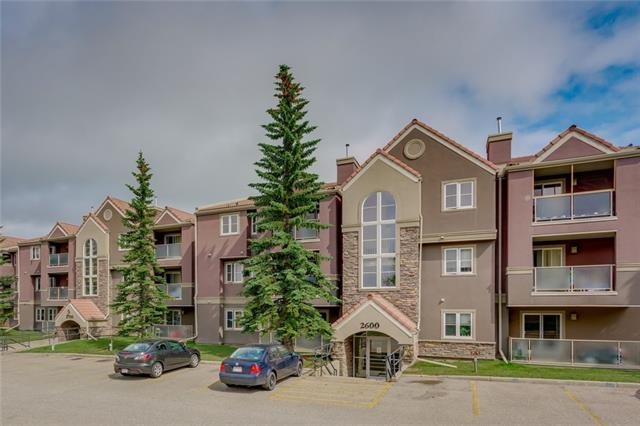 This is the largest style unit in the complex boasting 885 sq ft of living space. This 2 bedroom 2 bathroom unit offers a neutral palette with hardwood flooring in the main area, a corner gas stone fireplace in the living room, in-suite laundry with room for storage, and a south facing balcony just off the living area. The open kitchen/living floor plan is excellent for entertaining. The kitchen offers plenty of storage/counter space & stainless steel appliances. Both bedrooms are a great size, the master bedroom has a walk-through closet and 3 piece ensuite. Both bathrooms in the unit have been upgraded. Building amenities include a clubhouse with party room and kitchen, fitness room, indoor pool, hot-tub, and steam room. Complex upgrades (approximately 10 years ago) include new windows, patio doors, balcony, exterior stucco, and new building envelope. This unit is close to schools, shopping, dining, transit, and Nose Hill Park. The parking stall is directly outside the front entrance.