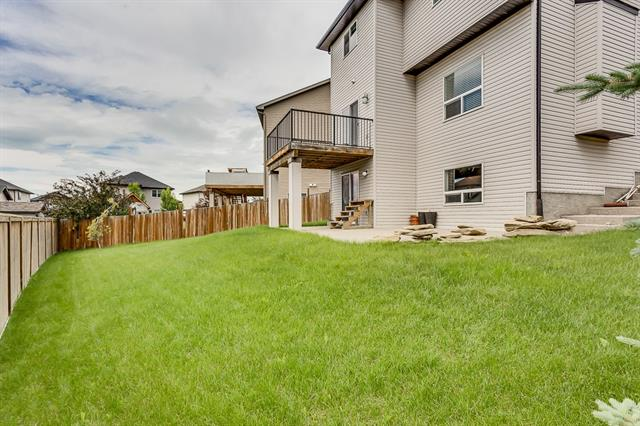 If you're looking for a WALK-OUT Home on a Large SOUTH-WEST FACING PIE LOT in a CUL-DE-SAC, then this is the perfect home for you. This great home is located in the Popular Community of Prairie Springs in Airdrie. As you enter this Fantastic Home, you will notice the Cathedral Ceilings in the Foyer and the staircase with metal spindles. The Open Concept main floor features a great Kitchen with Dark Cabinetry, Large Island with Granite Countertops, and Stainless Steel Appliances. The Living Room has a feature wall with Fireplace and a Large Window. The Dining area opens onto the Upper Deck. Main Floor Laundry. The upper level has a Bonus Room, Large Master Bedroom that can fit a King sized suite, 5 pc Ensuite with Soaker Jacuzzi Tub, and Walk in Closet. The upper level also has 2 additional bedrooms that are both spacious and another full bath. The Walk-out level has been framed and is ready for you to complete. This home has aggregate walkway along the home that expands into a huge patio. A must see!