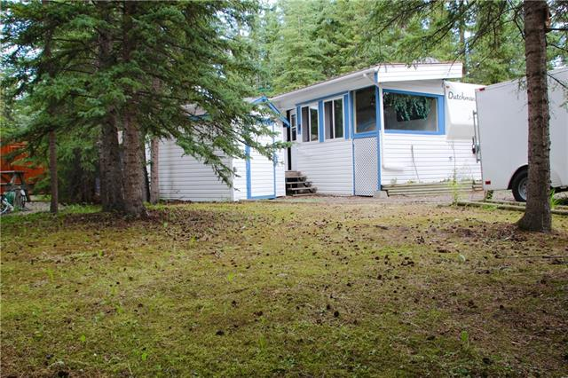 104 Riverside RV Village - A Hideaway in the trees. Large and deep lot with a 1995 30' Dutchmen 30RK-LE Fifth Wheel in great condition. Hasn't moved since new! Set back from the road on a deep lot with lots of parking and a lawn area up front. 12x18 grade-level deck in the back along with fire pit and screen gazebo. 8x10 shed for extra storage. Inside, the 30' addition has plenty of windows and two seating areas. Roomy fifth wheel is in great shape with back corner kitchen for those morning coffee moments. Riverside has seasonal town water and sewer and electricity and access year 'round. Nearby clubhouse with washrooms, showers, laundry, and party room. Playground and horseshoe pits. There are also year-round washroom and laundry facilities available. Only a minute's walk to the river and a few minutes to groceries and restaurants. Gated access. Come SEE this hideaway to appreciate it!