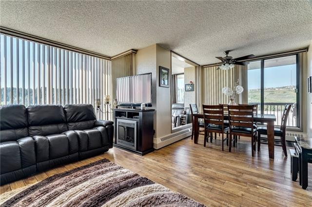 Open House Sun Nov 17 2:30-4:30.  Beautifully updated 2 bedroom condo in fabulous location overlooking Bow River & pathways, close to DT, hospitals, Edworthy park, Angels cafe, U of C.  This is a must see unit to appreciate the wonderful layout & WOW appeal w/warm colors & rich scraped wood floors highlighting the entire unit.  Updated kitchen with S/S appliances & large window overlooking city view, spacious living & dining rooms w/additional sunroom & office den area, large master bedroom w/walk in closet & 2 piece ensuite, updated bathrooms.  Newer lighting, insuite laundry, large balcony, indoor parking stall, extra stalls to rent, extra storage unit, car wash bay, visitor parking.   Adjoining Riverside Fitness, Tennis & Golf Club w/indoor access offering discounted rates for residents.  Fees include electricity, heat, wtr/swr, 24 hr security/concierge. Adult 18+, pet friendly. Well managed & maintained building w/numerous major building upgrades completed.  Incredible value, lifestyle & location!