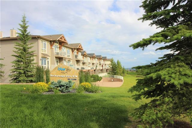 WEST Facing W SPECTACULAR MOUNTAIN & CITY VIEWS from both levels of this spectacular 2 bedrm,3 bath townhome condo WITH 9FT CEILINGS! ***CONDO FEE INCL HEAT(GAS) + WATER/SEWER***TITLED PRKG in heated prkg garage + additional titled storage unit. The main floor has a two piece bathrm with a window  & spacious living room open to the kitchen W  SS appliances/microwv hood-fan cover. MAIN FLR KITCHEN has plenty of storage W pantry, storage closet & shoe nook to keep your home tidy & organized. Carpet freshly cleaned, tile & wood laminate flooring in a perfect neutral color.  Exercise room, PET FRIENDLY & PLENTY of visitor parking makes this home ready for you to move in & enjoy immediately! The living room has a gas/hook-up for BBQ with STUNNING MOUNTAIN VIEWS bring a level of sophistication to this home. Upstairs has 2 bedrms, laundry, large master having its own 3pc en-suite bath. WALKING DISTANCE to LRT & a short drive to shops/restaurants, U of C/SAIT/Foothills & Children's Hospital. BUILDER SIZE 988sqft.