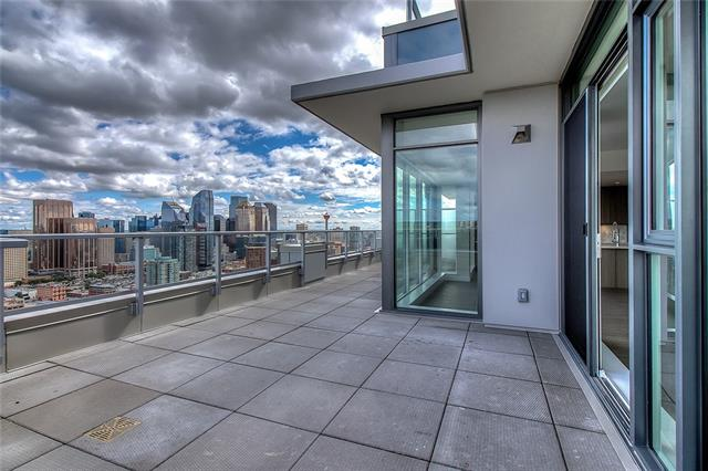 Enjoy the stunning & unrivalled 270 degree views of the downtown skyline to the Rockies through the floor to ceiling windows of this expansive 1961 sq ft brand new 32nd floor Penthouse in The Royal, offering two large decks, 3 bedrooms, central A/C, an contemporary open concept living with gourmet chef?s kitchen with upgraded cabinets, professional appliances & quartz counters. The master retreat offers a massive walk-in closet, spa inspired 5 piece ensuite & heated floors. Two additional bedrooms share a 5 piece bath, one with deck access. This Penthouse unit offers the best views & a private garage can house 3 vehicles & a spacious storage locker, insuite laundry room & Concierge services. The Club Royal membership offers numerous amenities including an outdoor garden patio retreat with BBQs, fire pit, bench seating, squash court, gym, steam & sauna, owner's lounge with pool table & a chef's kitchen. Urban Fare Foods, superb restaurants, Caf�?s, Shoppe?s, parks & amenities are all steps away.
