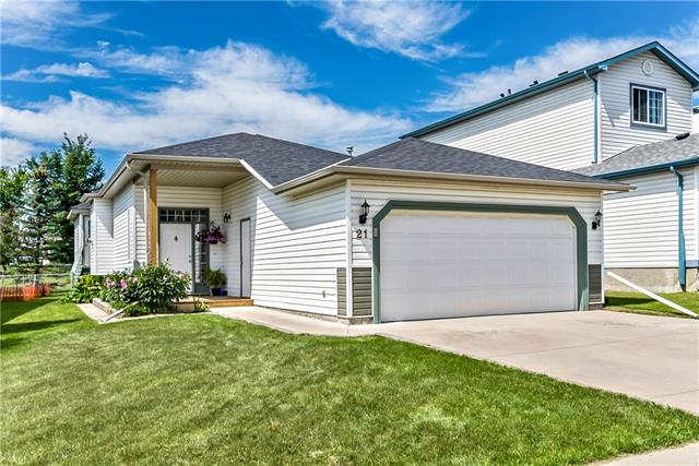 **OPEN HOUSE SUNDAY 2ND - 1:30-3:30**STEAL OF A DEAL!! SELLERS ARE MOTIVATED. GREAT LOCATION! This fully finished bi-level is located on a quiet cut-de-sac, backs onto green space, park AND walking path! Gorgeous maple hardwood floors and gas fireplace compliment the large living room. Bright white kitchen with tile backsplash boast a large pantry and dining area. Adjacent is a spectacular sunroom with a wood burning fireplace. An additional 158 sq ft of 3 season living beckons family and friends to gather on cool evenings around its ambient glow. Enjoy the west facing back yard from your pergola covered deck or mature yard. Large master bedroom, 2nd bedroom and 4 piece ensuite finish off the main floor. Fully finished basement offers a wonderful large family room, 2 large bedrooms and a 3 piece bath. Insulated double garage. Location is easy access in and out of town for commuters. Super cute home is ready for your family to move in! QUICK POSSESSION.