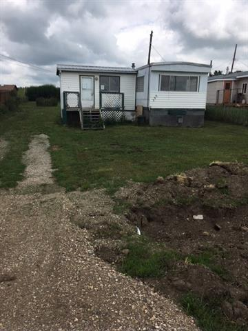 50 x 130 foot lot with 1967 Mobile home located in the town of Standard, 20 minutes east of Strathmore.  The Mobile home is 672 square feet with a 10 x 16 mudroom addition and it is in poor condition, making it perfect for a handyman special.  It could be renovated, removed and replaced with a new home or a newer Modular ( 8 years or newer).  Don't miss an excellent opportunity to buy property at this very affordable price.