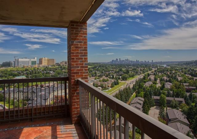 SUB PENTHOUSE, SPECTACULAR MILLION $ UNOBSTRUCTED VIEWS of Downtown, City & River in a location 2nd to none.  Steps to Bow river pathways & bike trails, mins to DT, hospitals, Edworthy park, U of C, shopping...  One of the largest 2 bdrm units in building w/2 UNDERGROUND PARKING STALLS.  Unique design featuring open kitchen, updated cabinets, S/S appliances & large window over sink.  Featuring rock faced pillars entering the dining & living rooms, cozy electric fireplace, heated tiles throughout & views from every room with sunny south balcony overlooking the river.  Large master bedroom w/walk in closet & 2 piece bathroom, 2nd good sized bedroom, 4 piece bathroom, Insuite laundry & large storage room.  Additional storage unit, car wash bay.  FABULOUS AMENITIES with indoor access to Riverside Fitness, Golf & Tennis Club with reduced fees for residents.  ADULT 18+ BUILDING, pet friendly!  Very well MANAGED & MAINTAINED with most of the major upgrades completed & paid for.