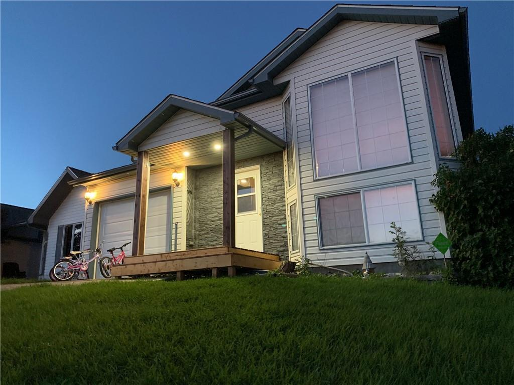 Great family home.  Walk in to a warm and spacious entryway, with a double closet and attached single garage access.  This 4 bedroom (3 up one down) bi-level, with 2.5 baths, has open concept living, an updated kitchen, with a raised second storey deck off the dining room with a beautiful valley view, a large living room, with adjoining rec space and a walk out basement.  The basement also offers unique storage options and a functional laundry room with storage.  The yard has low maintenance landscaping and 2 beautiful apple trees.
