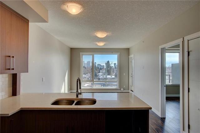 Brand new top floor corner unit, with downtown city views. This location can't be beat! It is just minutes from all the trendy shops and restaurants in Mount Pleasant, within walking distance to SAIT, ACAD, LRT and only 10 minutes to downtown, The University and Foothills Hospital. Your new 1 bed, 1.5 bath unit comes with 9 foot ceilings, large balcony, in-floor heating, secured and heated underground parking with built-in storage. This sunny south facing unit includes quartz counters, pantry and glass tile backsplash, as well as stainless steel appliances. Enjoy entertaining friends on the spacious balcony and the convenience of being within walking distance to all amenities. Other 1 bed/1.5 bath floorplans also available.