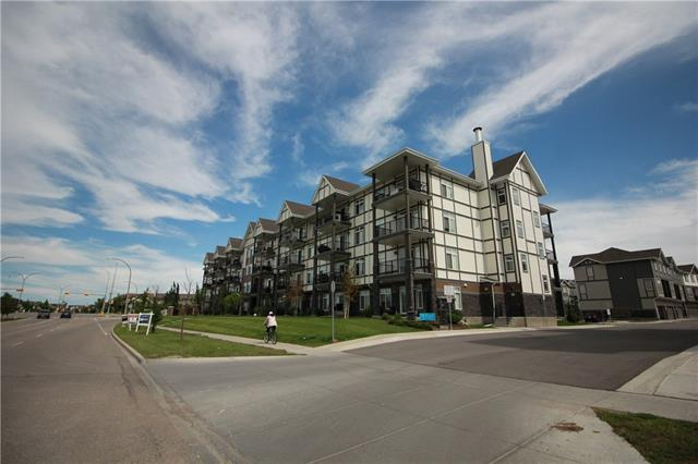 This is an amazing 2 bedroom End Unit condo facing the Pond with Mountain View. Features 9 foot ceiling, big windows and big balcony with sliding door; brand new laminate flooring in the kitchen & living room, tile in the laundry room & bathroom, triple pane windows, open concept kitchen & large living room, all stainless steel appliances, front loaded full size washer & dryer, and low condo fees. 1 bedroom has big window and the other bedroom has no window. Located in the popular community of New Brighton. Walking distance to K-6 school.  Home owners can access to Skating, Community Center and Parks. It also close to all amenities including shopping, restaurants, etc.  Few minutes to Stoney Trail & Deerfoot Trail. Very convenience location and dont miss this opportunity to own this for yourself or good investment holding property! Call us to view this place today. Long term tenant just signed another lease until Oct 31, 2020.