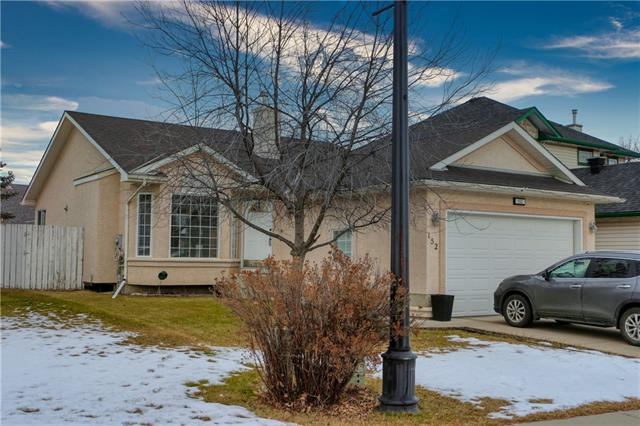 This beautiful bungalow on a quiet street has many upgrades & updating including hardwood/ tile floors through the main living areas, & vaulted ceilings. The large kitchen has an oversized island, stainless steel appliances (incl. gas stove), lots of cupboard/counter space & corner pantry. The large dining/living area features large windows overlooking yard & gas fireplace. The kingsized master bedroom features both walk-in closet & newly updated ensuite with dual sinks, heated floors & oversized shower. The other main floor bedroom is spacious, as is the front room. You?ll find plenty of room to park in the attached double garage. The fully developed basement provides a massive family room, games areas, full bathroom & bedroom. There?s also lots of storage space throughout the home. The easy care back yard is fully fenced, with newer deck, gas line & mature trees. Just a short walk from the Lakeview Golf Club & Chestermere Lake. Close to schools, shopping, services, less than 30 min. to downtown Calgary.