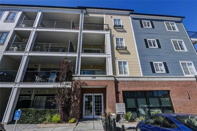 "Priced well! You do not have to pay for all the upgrades or GST with this 2017 built, Award Winning design. This Beautiful 2 bed- 2 bath-2 titled parking Main Floor Corner Unit has it all. Your stunning oasis comes complete with tons of upgrades: central A/C, upgraded kitchen & living room lighting, durable comfort plank flooring, quartz countertops throughout, beautiful stainless steel appliances, ""soft-touch"" cabinetry, pull out pantry doors, larger cabinets and front closet, complete blind package, in-suite front load washer & dryer, & so much more. Enjoy your summer patio with gas BBQ hookup with family & friends. You will also appreciate having a parking stall right beside. It is perfect for groceries & day to day living. For winter, you will love a heated underground parking stall & storage unit as well. Great playground/park Ponds & pathways right across the road! Easy access to transit and shopping nearby. It is affordable and has it all, you do not want to miss this great value, call today."
