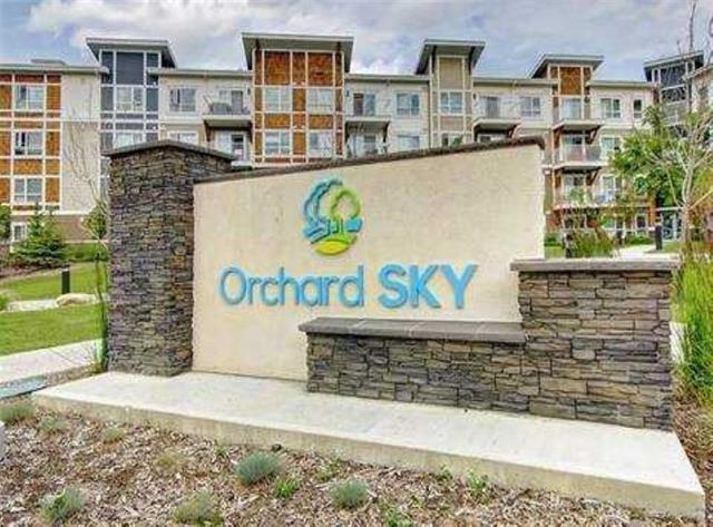 Welcome to Orchard Sky in family-friendly Skyview Ranch! This bright and modern 2 BED/2 BATH apartment is in show home condition. The kitchen area comes complete with stainless steel appliances, exquisite quartz countertops, and plenty of cabinet space. This open concept design unites the dining and living room area and leads to an outside deck overlooking natural green space. Master bedroomwith HIS/HER closets and large enough to accommodate a KING size bed. Conveniently located just steps away from an elementary school, playgrounds, and walking paths. Future location of Sky Pointe Towne Center with LRT station, recreation center, and a public library. Only minutes from the airport with easy access to major roadways Stoney Trail and Deerfoot.