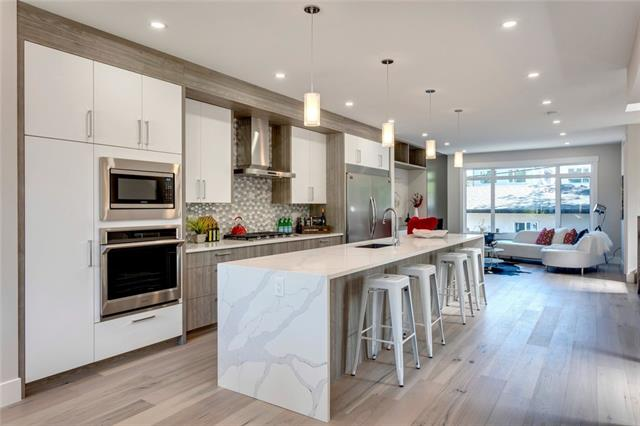 """OPEN HOUSE Sat, Oct 19: 11:30-1:30! Spruce Cliff welcomes this brand new infill, strides ahead of the competition in design, style, finishes and quality! Sunny west exposure on a beautiful, tree-lined street and totaling over 2,660 SQ FT of functional living space! Loaded with designer cabinetry, glass tile back splash, an expansive 14 FT waterfall quartz island and stainless steel Samsung appliances. Check out the 64"""" built-in refrigerator! Notable features include: LED lighting, wide-plank, white oak engineered hardwood on 2 levels, a stunning master bedroom, a spa-inspired ensuite with a free-standing soaker tub, heated floors and large walk-in closets in all bedrooms. Wired for audio/home automation throughout. Roughed-in for: central AC, in-floor heat (lower level) and central vac. The lower level is well-appointed with upgraded luxury carpet in basement, a compete wet bar with beverage fridge, a media room area with custom built-ins, a three piece bath, fourth bedroom and plenty of storage."""