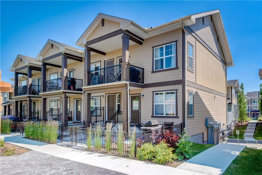 Price adjusted! Excellent, next to new, 2 bedroom, corner unit condo with single level living on the top floor and overlooking the treed park. Located in the very desirable NW community of Evanston, close to shopping, restaurants, amenities and quick access to Stoney Trail and Airport. This home has a balcony with gas barbeque hook-up as well as  a fenced garden area in front. There is also an attached single garage & plenty of visitor parking in complex. This open design, contemporary unit has a kitchen with centre island, gas stove, lots of cabinets, vaulted ceilings, pantry and dark laminate flooring. There are 2 bedrooms, the master having a walk-in closet. A 4 piece bath with tile floors & laundry area adjacent to bedrooms. There is extra storage coming in from the attached garage. This is an excellent, very affordable first home with low condo fees & quick possession available.